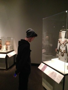 Logan Torve investigating the artifacts from Mycenaean period at the Chicago Field Museum.